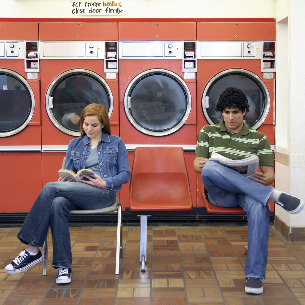 Man and Woman Waiting in Laundromat